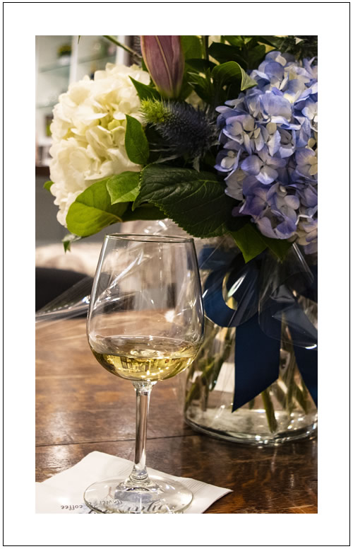 Hydrangea flowers and glass of wine, Photo by Kelsey Knight
